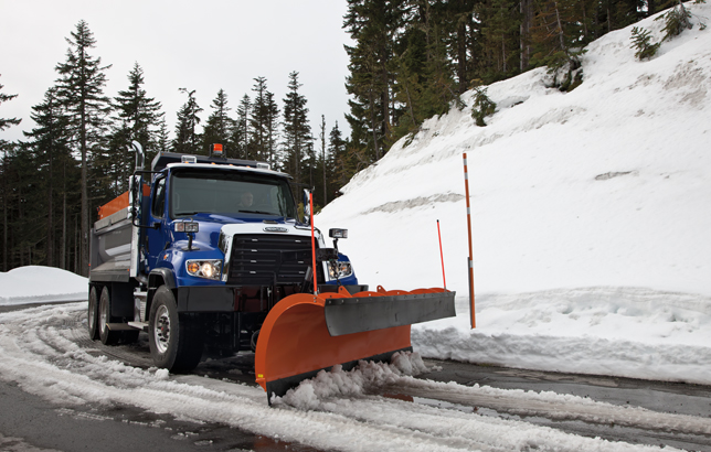 A Freightliner 114SD snow plow keeping the streets clean.